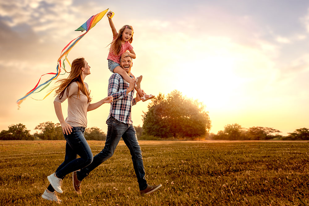 Happy family flying a kite
